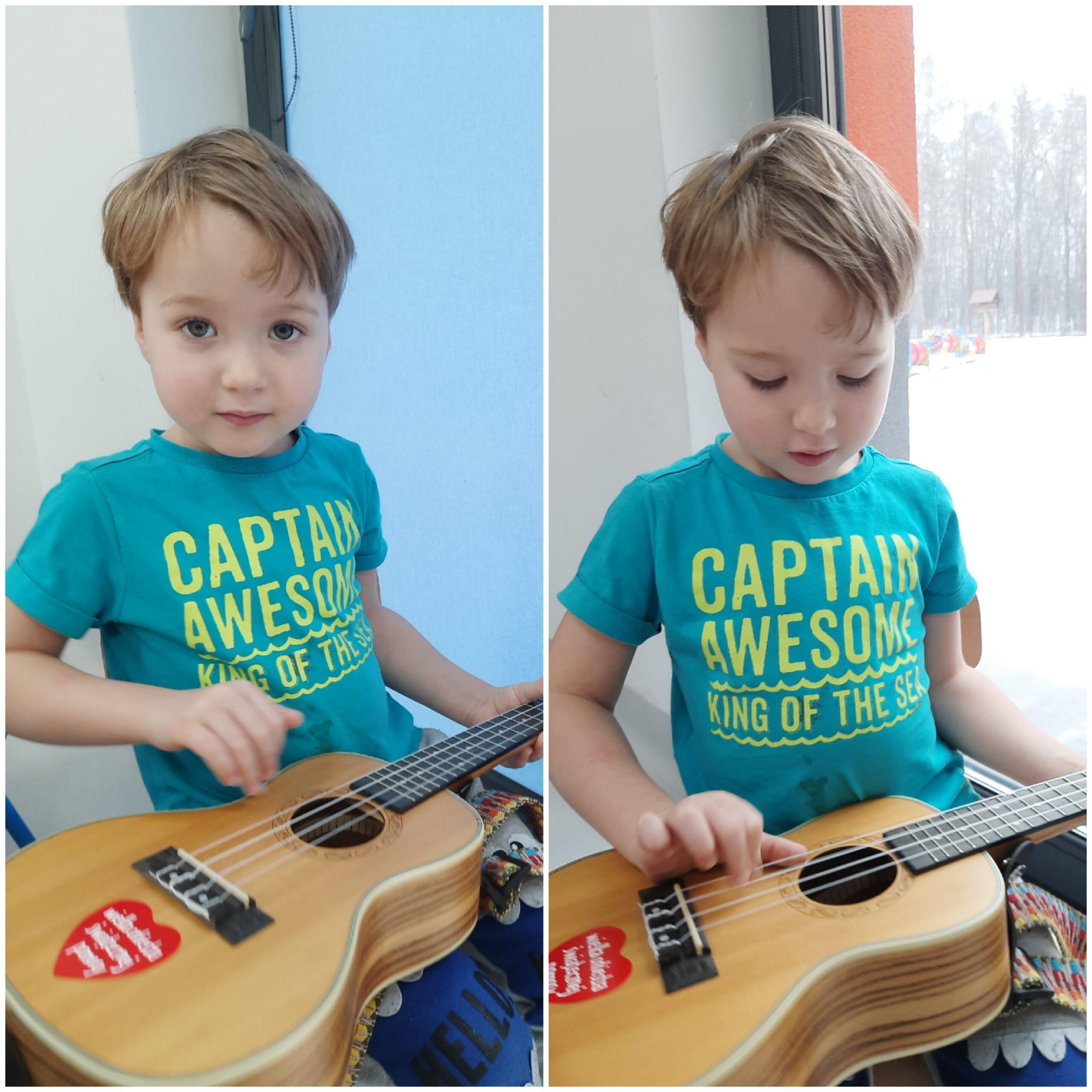 dziecko grające na ukulele